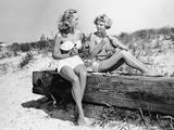 Two Women Drinking Soda on Beach