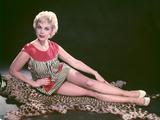 Blonde on Leopard Rug