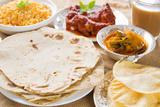 Chapatti Roti or Flat Bread  Curry Chicken  Biryani Rice  Salad  Masala Milk Tea and Papadom India