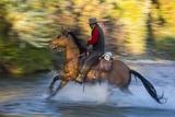 Cowboy Riding through River on a Horse