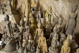 Buddha Statues in Pak Ou Caves outside of Luang Prabang  Laos
