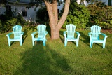 Turquois Lawn Chairs and Green Grass at Sunset