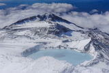 Aerial of a Tuquoise Crater Lake on Top of Mount Ruapehu  Tongariro National Park  North Island