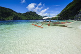 Outrigger Boat in the Crystal Clear Water in the Bacuit Archipelago  Palawan  Philippines