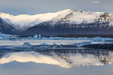 View over Jokulsarlon Glacial Lagoon Towards Snow-Capped Mountains and Icebergs