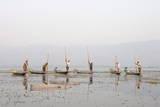 Intha Leg Rowing Fishermen at Dusk  Inle Lake  Nyaungshwe  Shan State  Myanmar (Burma)  Asia