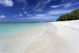 Idyllic Beach Scene with Blue Sky  Aquamarine Sea and Soft Sand  Ile Aux Cerfs