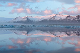 Panoramic View across the Calm Water of Jokulsarlon Glacial Lagoon Towards Snow-Capped Mountains