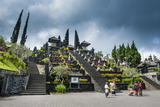 Stone Statues with Colourful Capes in the Pura Besakih Temple Complex  Bali  Indonesia