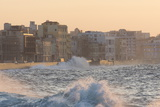 Buildings Along the Malecon in Soft Evening Sunlight with Large Waves Crashing Against the Sea Wall
