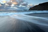 Sea Stacks of Reynisdrangar at Sunrise from the Black Volcanic Sand Beach at Vik I Myrdal
