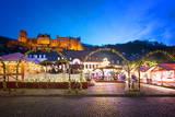 Christmas Market at Karlsplatz in the Old Town of Heidelberg  with Castle Heidelberg  Heidelberg