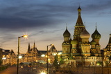 Gum Department Store and Onion Domes of St Basil's Cathedral in Red Square Illuminated at Night