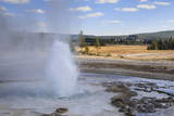 Erupting Geyser and Old Faithful Inn  Upper Geyser Basin  Yellowstone National Park  Wyoming  Usa