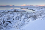 Pingvallavatn Lake with the Shore and Distant Mountains Covered in Snow