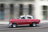 Panned Shot of Vintage American Car on the Malecon  Havana  Cuba