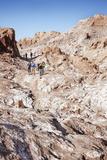 Tourists Climbing over the Top of Chulacao Caves  Moon Valley  Atacama Desert