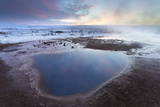 Steam Rising from Geothermal Pools at Sunrise in Winter  Geysir  Haukardalur Valley