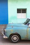 Vintage American Car Parked in Front of the Green and Blue Walls of a Colonial Building