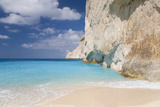 Limestone Cliffs Towering Above Turquoise Sea  Navagio Bay  Anafonitria