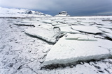 Winter View over Slabs of Broken Lake Ice Covered in Snow Towards Kirkjufell (Church Mountain)