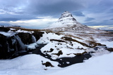 Kirkjufell (Church Mountain) Covered in Snow with a Frozen River and Waterfall in the Foreground