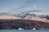 Nearly Full Moon Setting in the Early Morning Near Qilakitsoq  Greenland  Polar Regions