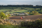 Tractor Ploughing Fields in Blockley  the Cotswolds  Gloucestershire  England