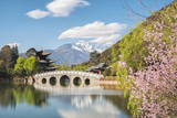 Black Dragon Pool with Moon Embracing Pagoda and Suocui Bridge in Jade Spring Park of Lijiang