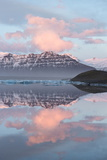 Panoramic View across the Calm Water of Jokulsarlon Glacial Lagoon Towards Snow-Capped Mountains