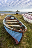 View Towards Lindisfarne Castle with an Old Blue and Red Fishing Boat in the Foreground