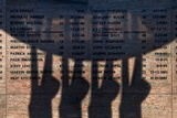 Shadow of the Fishermens Memorial and Wall of Honour  Dunmore East Fishing Port