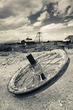 Tire with Desert Queen Hoist House and Mine in the Background  Tonopah Historic Mining Park