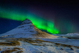 Aurora Borealis or Northern Lights over Mt Kirkjufell  Snaefellsnes Peninsula  Iceland