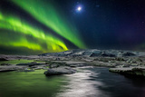 Moon and Aurora Borealis, Northern Lights with the Moon Illuminating the Skies and Icebergs Papier Photo par Green Light Collection
