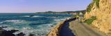 Couple Riding Bicycles Along California Coast  Monterey  California  USA