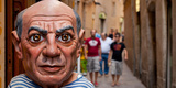 Close-Up of a Sculpture of Pablo Picasso a Spanish Painter at the Entrance of a Shop