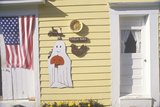 Halloween Decorations and an American Flag on a Yellow Wooden House
