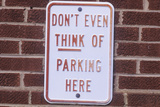 "A Sign That Reads ""Don't Even Think of Parking Here"""