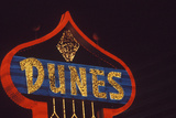 "A Neon Sign That Reads ""Dunes"""
