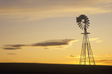 Silhouetted Wooden Windmill at Sunset  South Dakota