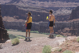 Two Hikers with Water Bottles Resting in Canyonlands  Utah