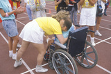 Special Olympics Athlete in Wheelchair  Crossing Finish Line  Being Congratulated  UCLA  CA