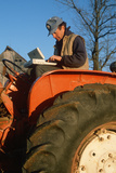 Farmer Working on Laptop Computer on His Tractor  Missouri