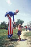 Uncle Sam on Stilts Shaking Girl's Hand  Salina  Kansas