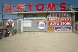 Old Antique Gas Signs of on Automobile Shop Near Barstow  CA Off of Route 58