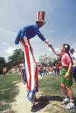 Man on Stilts Dressed as Uncle Sam Shaking Girl's Hand  Salina  Kansas