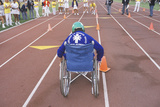 Wheelchair Special Olympics Athlete from Behind  UCLA  CA