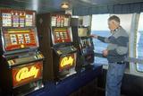 A Ferry Passenger at the Slot Machines  En Route to Nova Scotia