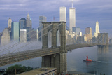 View of New York Skyline  Brooklyn Bridge over the East River and Tugboat in Fog  NY